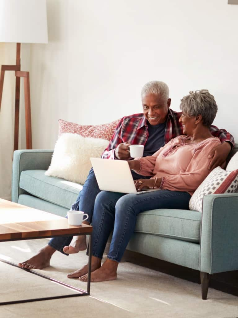 https://generationslawgroup.com/wp-content/uploads/2019/10/senior-couple-sitting-on-sofa-at-home-using-laptop-to-shop-online-picture-id992096396.jpg